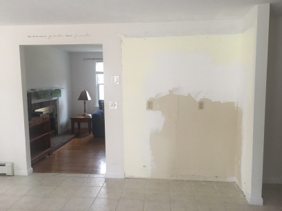 The wall looks unfinished because I have removed a set of built-on floor-to-ceiling maple cabinets.